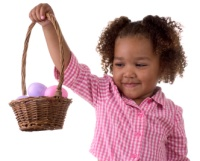 girl carrying easter eggs